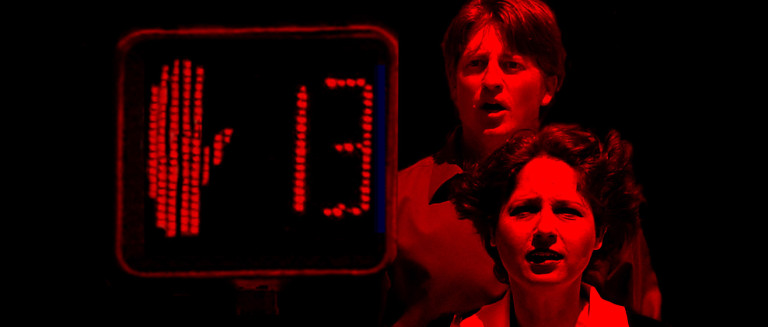 Michael (Don Martin) and Gwen (Dana Cory) confront the dangers of a 'CrossWalk' in Hidden Deadly's short comedy film.