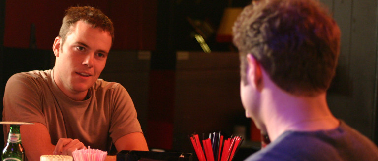 Sean (Wayne Webb) flirts with the bartender in Hidden Deadly's 'The Point of Boxes.'